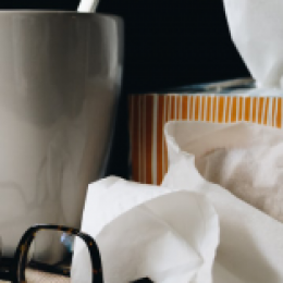Mug of tea, tissue and, glasses