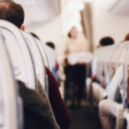 Airplane seats with rows of people